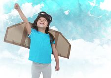 Smiling kid pretending to be a pilot against clouds Royalty Free Stock Photography
