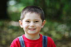 Smiling kid in red Stock Photo