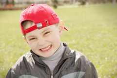 Smiling kid in red cap Royalty Free Stock Photos
