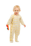 Smiling kid standing with rattle Stock Photography