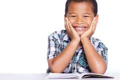 Smiling kid studying. Isolated on whitebackground Stock Photos