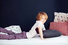 Smiling kid waking up languidly in the morning Stock Photography