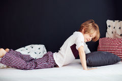 Smiling kid waking up languidly in the morning Royalty Free Stock Photography