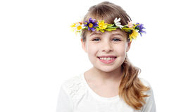 Smiling kid wearing flower wreath Stock Photos