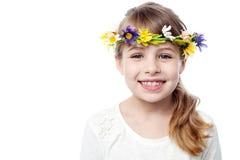 Smiling kid wearing flower wreath Stock Photos