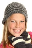Smiling Kid wearing Gloves. Lovely young girl kid in woolen hat and mittens Stock Photo