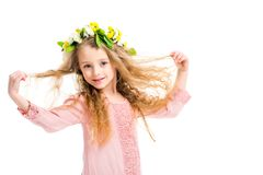 Smiling kid wearing wreath band from flowers and holding her hairs. Isolated on white stock photography