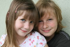 Smiling kids. Young girl & boy with blue eyes smiling Stock Images