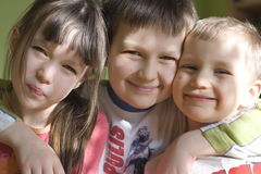 Smiling kids. Sister and brothers stock photo