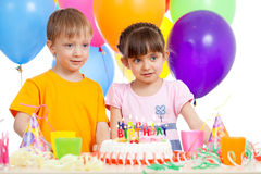Smiling kids with birthday cake and color ballons Stock Image