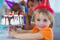 Smiling kids at a birthday party Stock Images