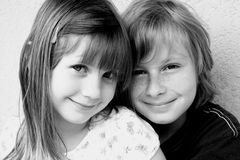 Smiling kids in black and whit. Young girl & boy smiling in black and white stock image