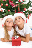 Smiling kids at christmas Stock Photos