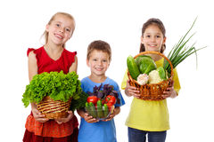 Smiling kids with fresh vegetables Stock Image