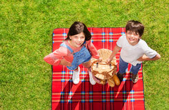 Smiling kids with hand basket for outdoor picnic. Top view portrait of smiling boy and girl holding hand basket for outdoor picnic Stock Photography