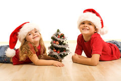 Smiling kids laying on the floor at christmas time Royalty Free Stock Image