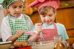 Smiling kids make a mess in the kitchen Royalty Free Stock Photo