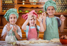 Smiling kids make a mess in the kitchen Royalty Free Stock Images