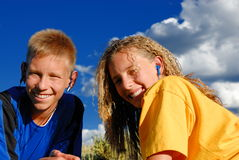Smiling kids in the meadows royalty free stock photography