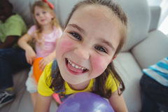 Smiling kids playing with balloons Royalty Free Stock Photos
