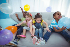 Smiling kids playing with balloons Stock Photography