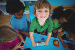 Smiling kids playing with modelling clay Royalty Free Stock Photography