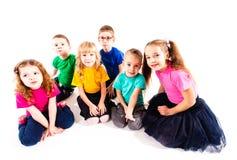 Smiling kids sitting stock photos