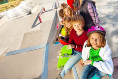 Smiling kids with skateboards and helmets Stock Photos