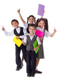 Smiling kids standing with books Stock Photos