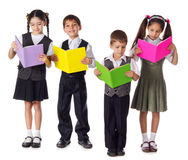 Smiling kids standing with books Royalty Free Stock Photography