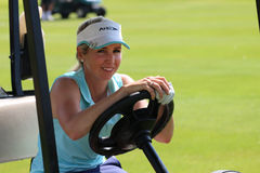 Smiling ladies pro golfer Daniella Montgomery behind steering wh Royalty Free Stock Photography