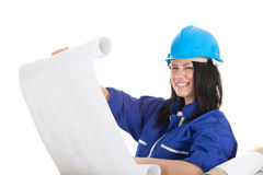 Smiling lady architect holding  blueprint Stock Photo