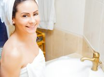 Smiling lady in bathrobe Royalty Free Stock Image