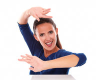 Smiling lady in blue shirt gesturing dancing Stock Image