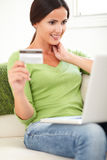 Smiling lady buying online with credit card Royalty Free Stock Photo