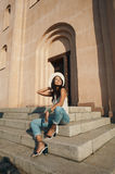 Smiling lady in casual summer outfit against ancient building Royalty Free Stock Images