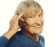 Smiling lady communicating through mobile phone Royalty Free Stock Photography