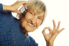 Smiling lady communicating through mobile phone Stock Images