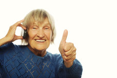 Smiling lady communicating through mobile phone Stock Photography