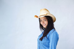 Smiling lady with cowboy hat Stock Image