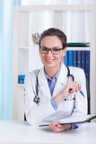 Smiling lady doctor with glasses Royalty Free Stock Photography