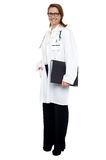Smiling lady doctor with medical file in hand Stock Photos