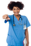 Smiling lady doctor pointing you out Stock Image