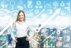 Smiling lady and drawn business icons on the background. Stock Photos