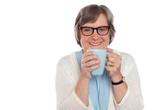 Smiling lady drinking hot coffee Stock Photo