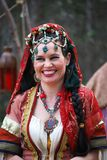 Smiling Lady in Gypsy Costume at Medieval Fair stock photography