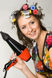 Smiling lady with hair dryer. Colourful portrait of smiling lady with hair dryer stock photography