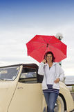 Smiling lady next to vintage car Royalty Free Stock Photo