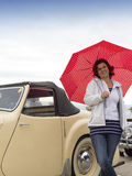 Smiling lady next to vintage car Royalty Free Stock Photography
