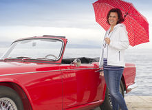 Smiling lady next to vintage car Stock Images